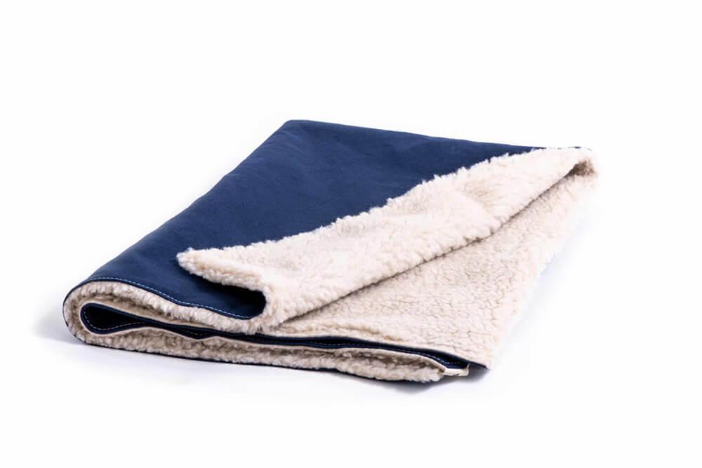blue dog blanket by Wagwear showing fleece inside material