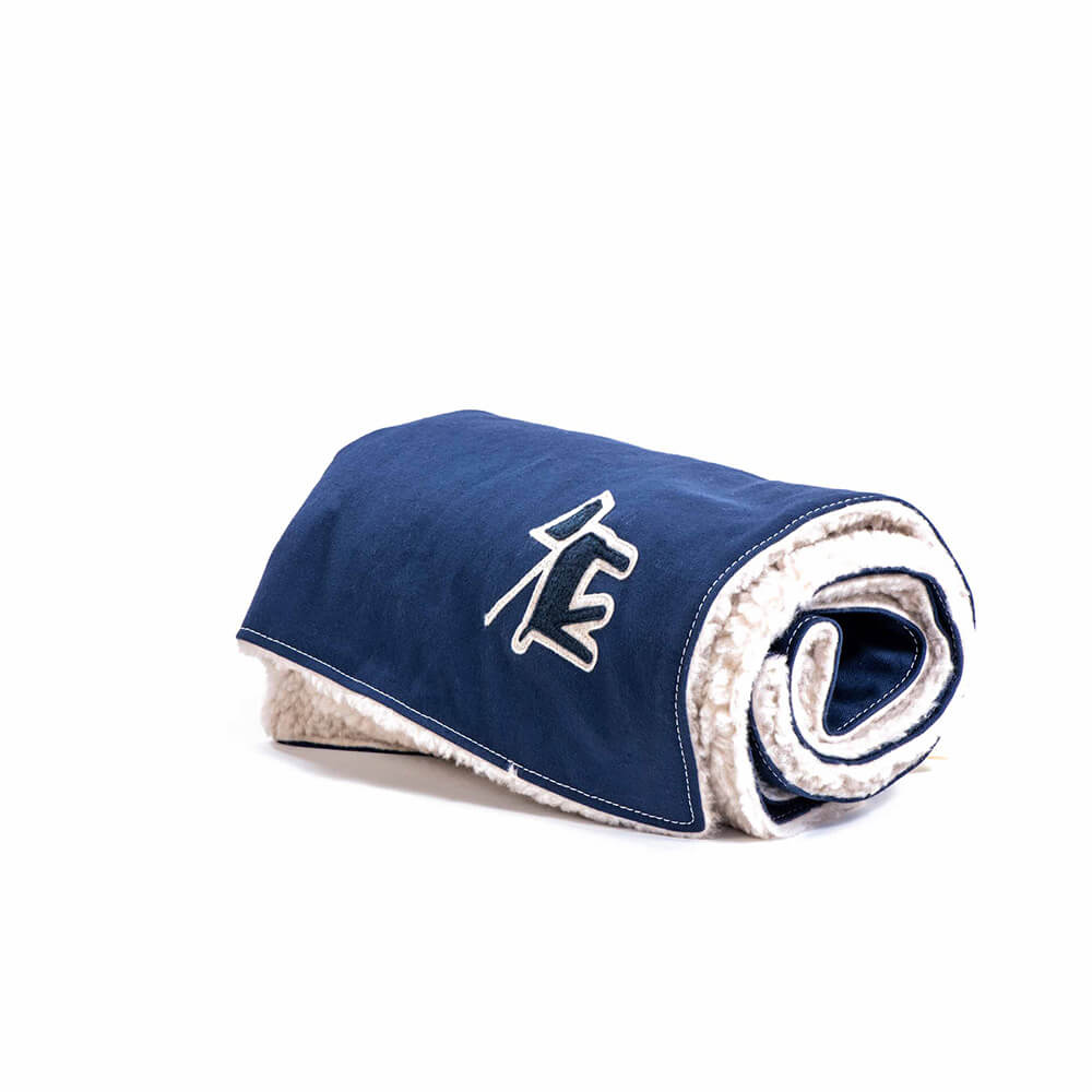 blue dog blanket by Wagwear using canvas & fleece material showing a dog decal on corner